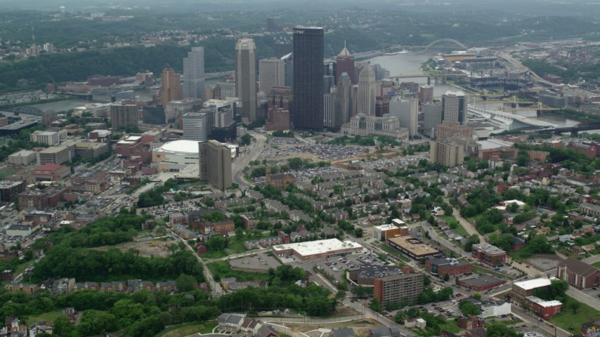 5K stock footage aerial video flying over homes and approaching Downtown Pittsburgh, Pennsylvania Aerial Stock Footage   AX105_180