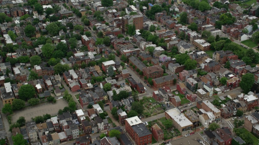 5K stock footage aerial video flying over residential town houses, Pittsburgh, Pennsylvania Aerial Stock Footage | AX105_206