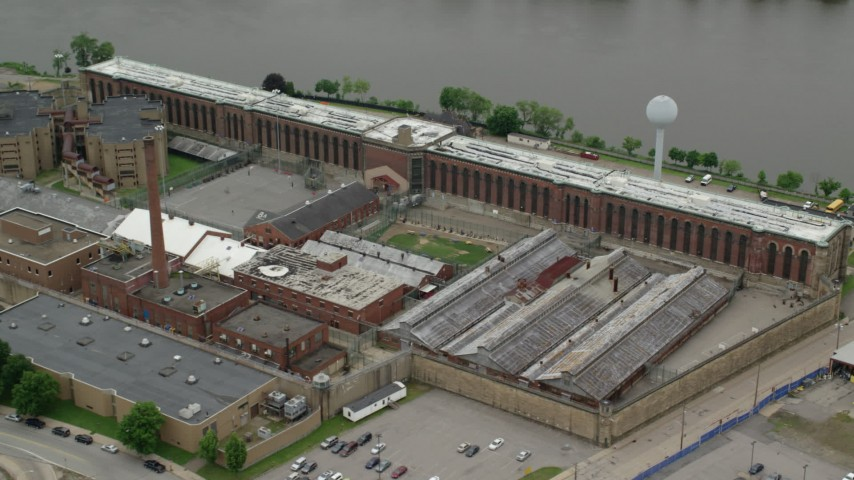 5K stock footage aerial video orbiting Western State Penitentiary, Pittsburgh, Pennsylvania Aerial Stock Footage | AX105_210