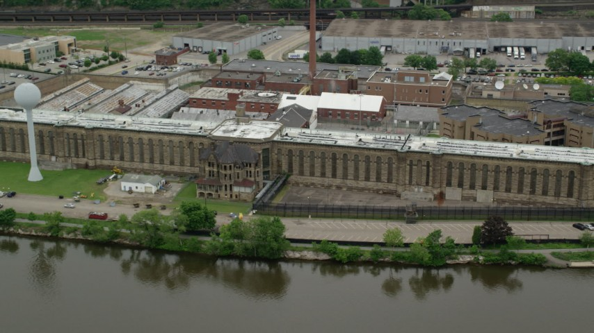 5K stock footage aerial video orbiting Western State Penitentiary, Pittsburgh, Pennsylvania Aerial Stock Footage | AX105_213