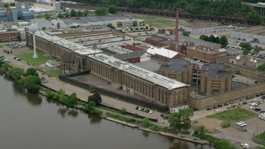 5K stock footage aerial video orbiting Western State Penitentiary, Pittsburgh Aerial Stock Footage | AX105_214