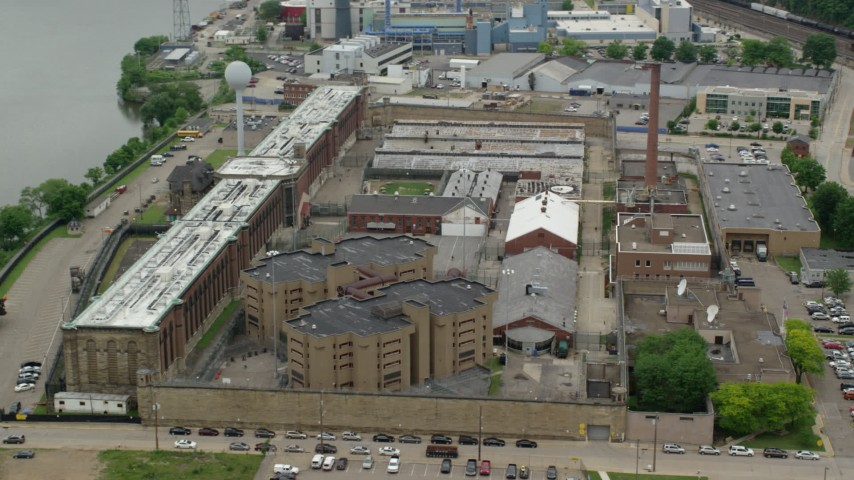 5K stock footage aerial video orbiting Western State Penitentiary, Pittsburgh Aerial Stock Footage AX105_215