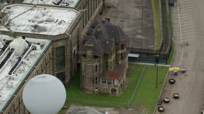 5K stock footage aerial video of an old building at Western State Penitentiary, Pittsburgh, Pennsylvania Aerial Stock Footage | AX105_219
