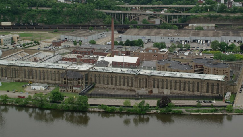 5K stock footage aerial video orbiting Western State Penitentiary, Pittsburgh, Pennsylvania Aerial Stock Footage | AX105_221