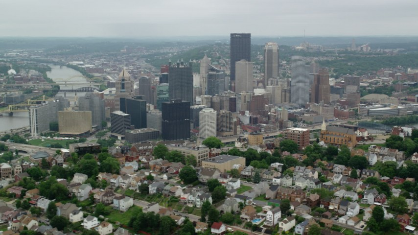 5K stock footage aerial video of Downtown seen from Hilltop Suburbs, Downtown Pittsburgh, Pennsylvania Aerial Stock Footage | AX105_231