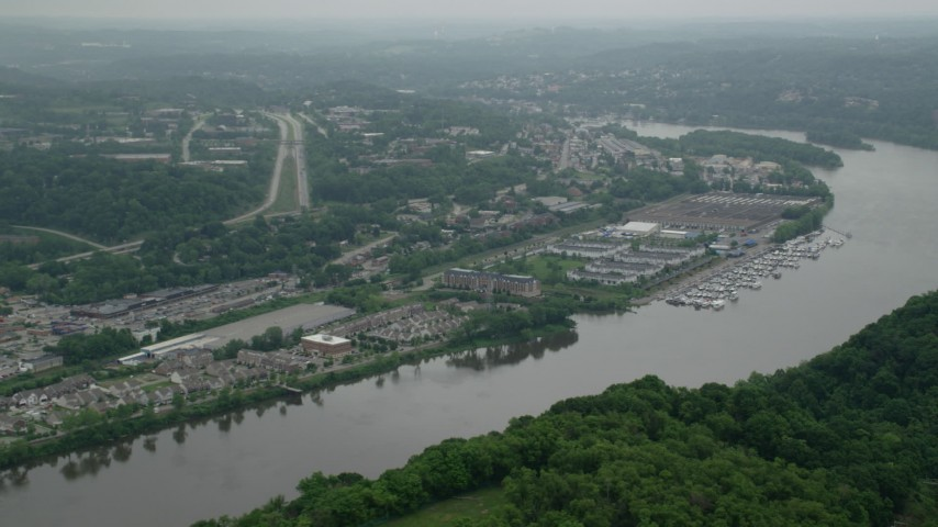 5K stock footage aerial video of riverfront office buildings and marina, Pittsburgh, Pennsylvania Aerial Stock Footage | AX105_246