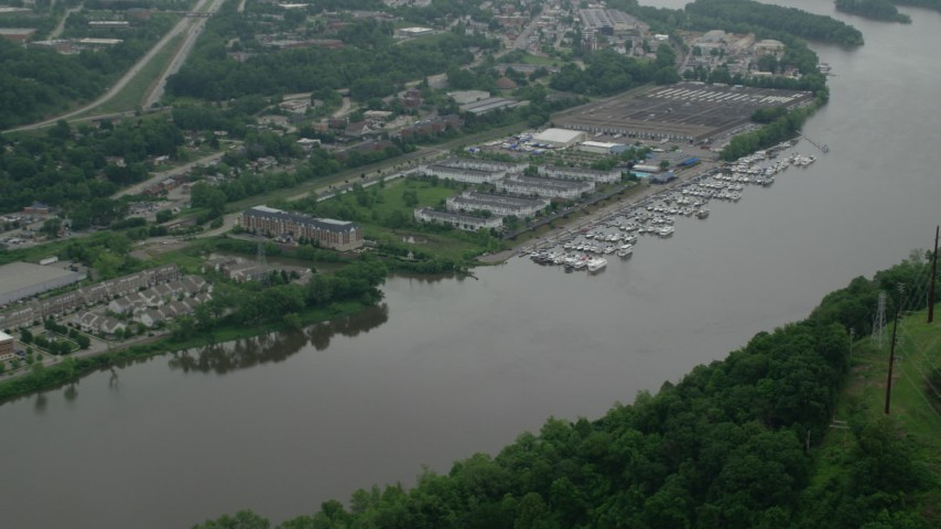 5K stock footage aerial video of riverfront office buildings and marina, Pittsburgh, Pennsylvania Aerial Stock Footage | AX105_247