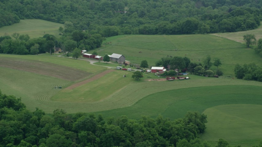 5K stock footage aerial video of a ranch house and a red barn, Pittsburgh, Pennsylvania Aerial Stock Footage | AX105_257