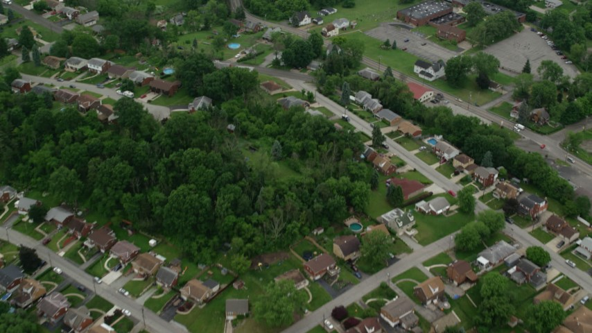 5K stock footage aerial video flying over suburbs revealing freeway, Pittsburgh, Pennsylvania Aerial Stock Footage | AX105_259