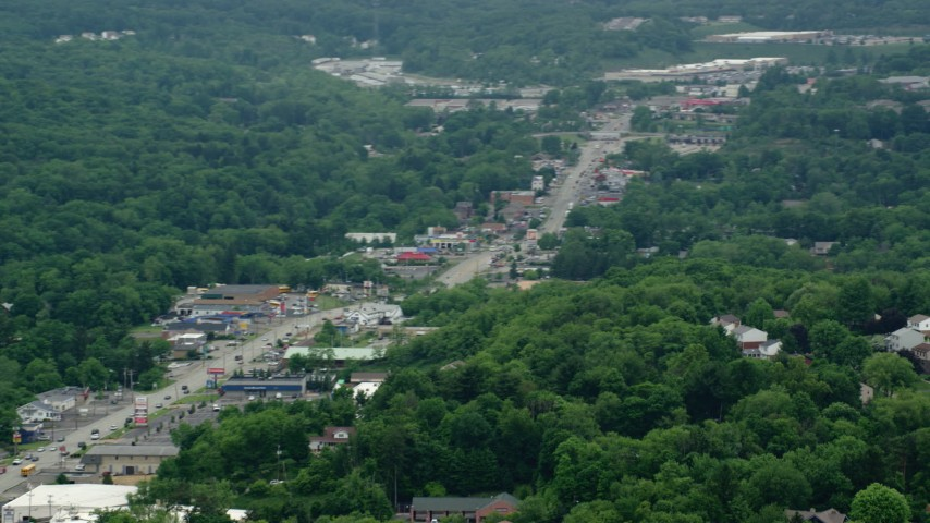 5K stock footage aerial video of shops by the Highway through Allison Park, Pennsylvania Aerial Stock Footage | AX106_013