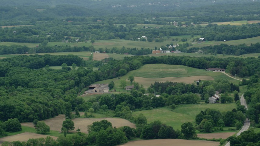 5K stock footage aerial video orbiting rural homes in Cranberry Township, Pennsylvania Aerial Stock Footage   AX106_028