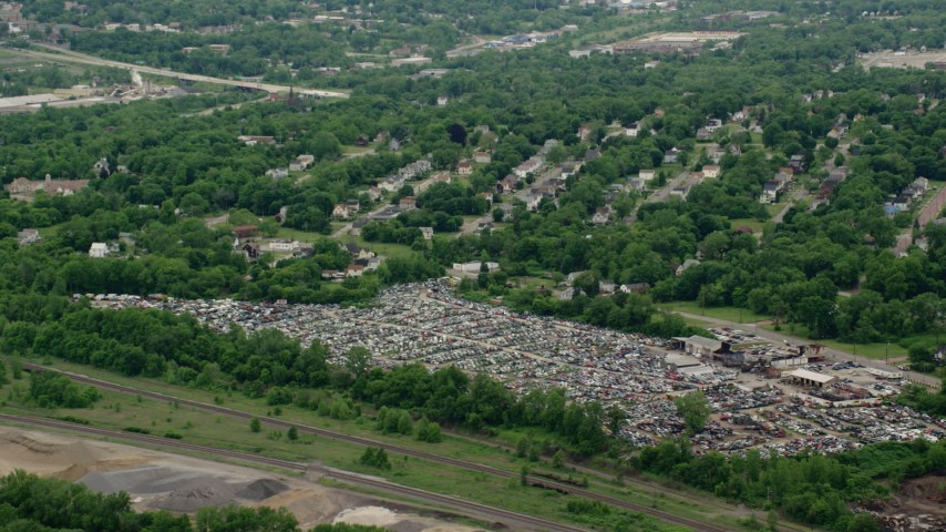 5K stock footage aerial video approaching an auto junkyard in Youngstown, Ohio Aerial Stock Footage | AX106_074