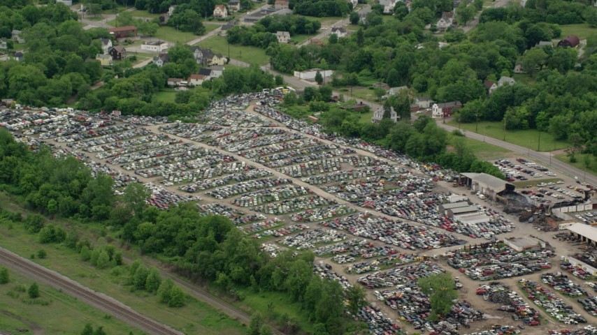 5K stock footage aerial video orbiting an auto junkyard, Youngstown, Ohio Aerial Stock Footage | AX106_075