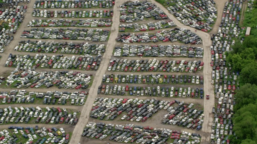 5K stock footage aerial video orbiting cars in an auto junkyard in Youngstown, Ohio Aerial Stock Footage | AX106_076