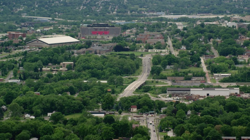 5K stock footage aerial video of campus buildings and stadium, Youngstown State University, Ohio Aerial Stock Footage AX106_094 | Axiom Images