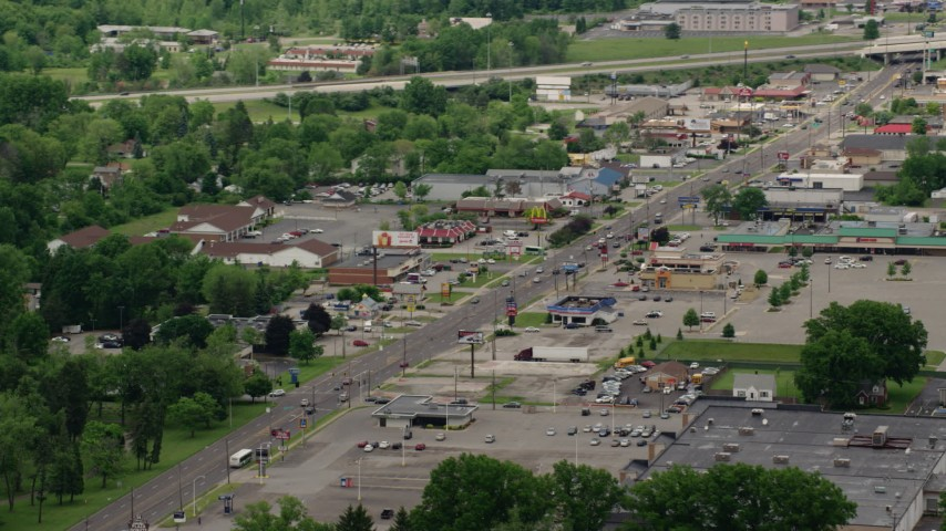5K stock footage aerial video of a city street, shops and strip mall in Youngstown, Ohio Aerial Stock Footage | AX106_101