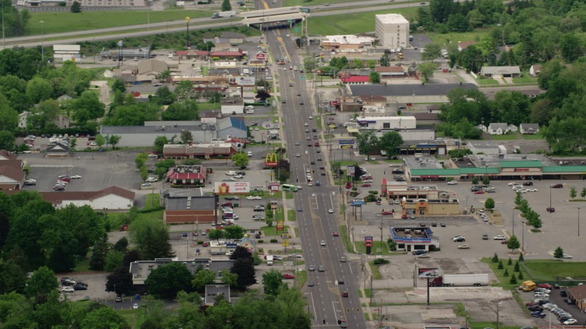 5K stock footage aerial video shops and strip mall by busy street in Youngstown, Ohio Aerial Stock Footage | AX106_102