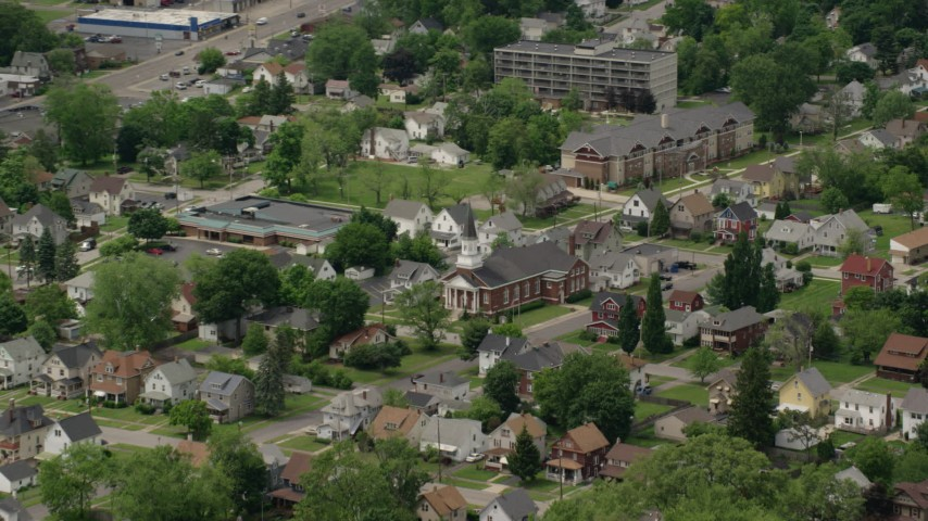 5K stock footage aerial video of church and homes in Youngstown, Ohio Aerial Stock Footage | AX106_104