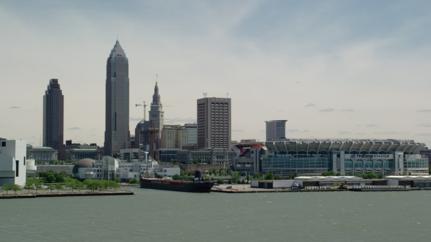5K aerial video of skyline and waterfront stadium in Downtown Cleveland, Ohio Aerial Stock Footage | AX106_207