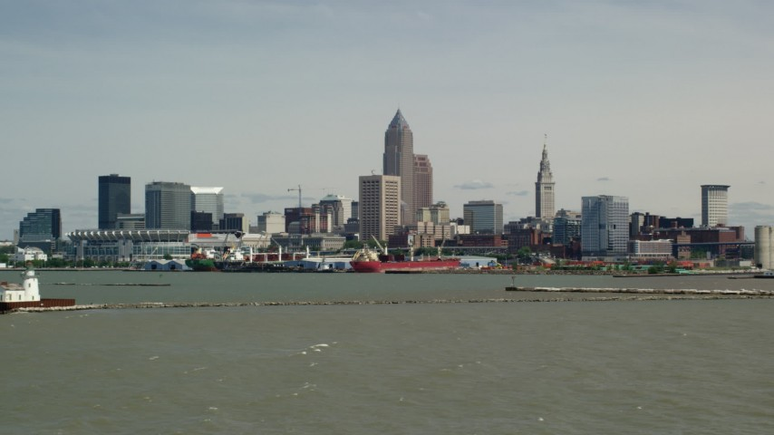 5K stock footage aerial video of skyline seen from a lighthouse, Downtown Cleveland, Ohio Aerial Stock Footage | AX106_209