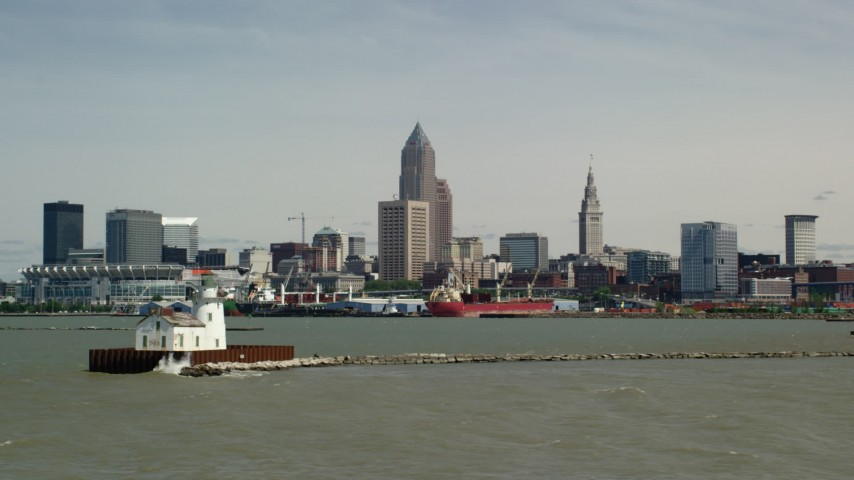 5K stock footage aerial video of the skyline seen from a lighthouse, Downtown Cleveland, Ohio Aerial Stock Footage AX106_210
