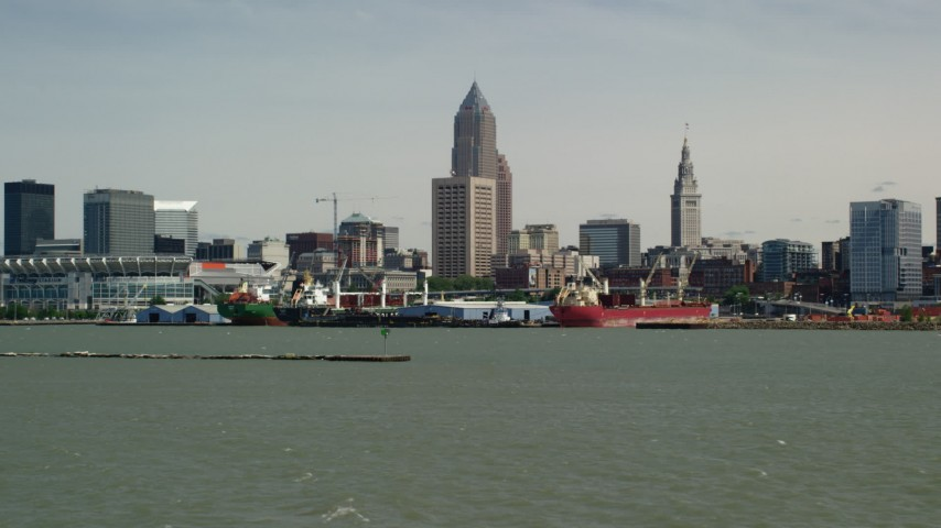 5K aerial video of the waterfront and skyline in Downtown Cleveland, Ohio Aerial Stock Footage | AX106_211
