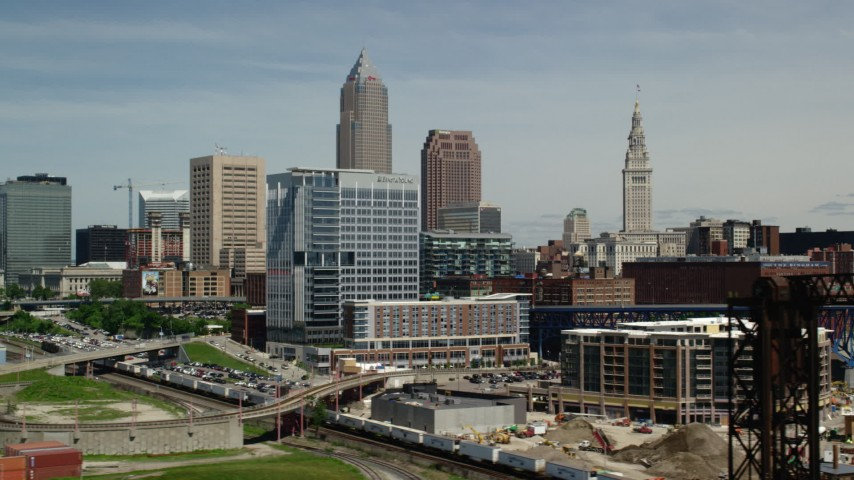5K stock footage aerial video of skyscrapers and riverfront buildings in Downtown Cleveland, Ohio Aerial Stock Footage | AX106_214