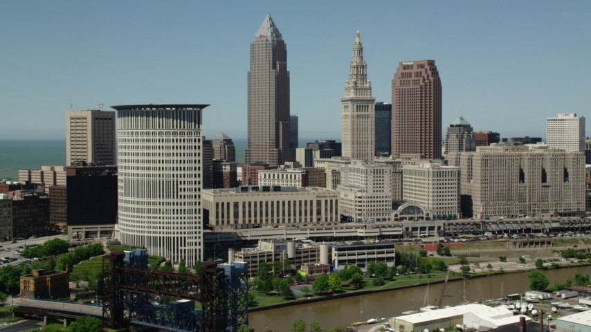 5K stock footage aerial video of riverfront skyscrapers in Downtown Cleveland, Ohio Aerial Stock Footage | AX106_218