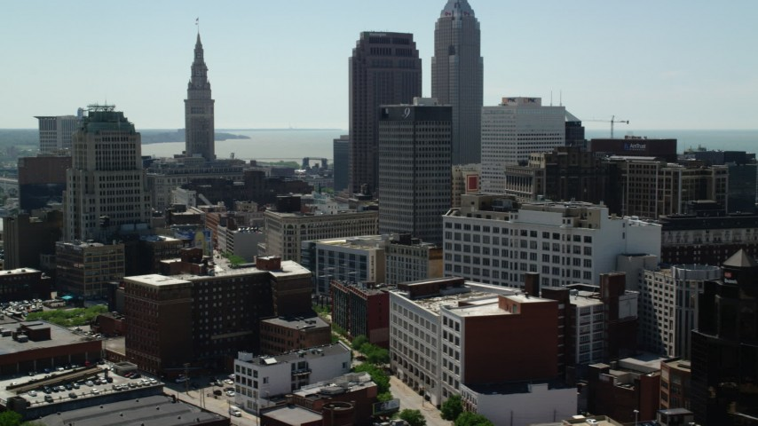 5K aerial video of skyscrapers and city streets in Downtown Cleveland, Ohio Aerial Stock Footage | AX106_224