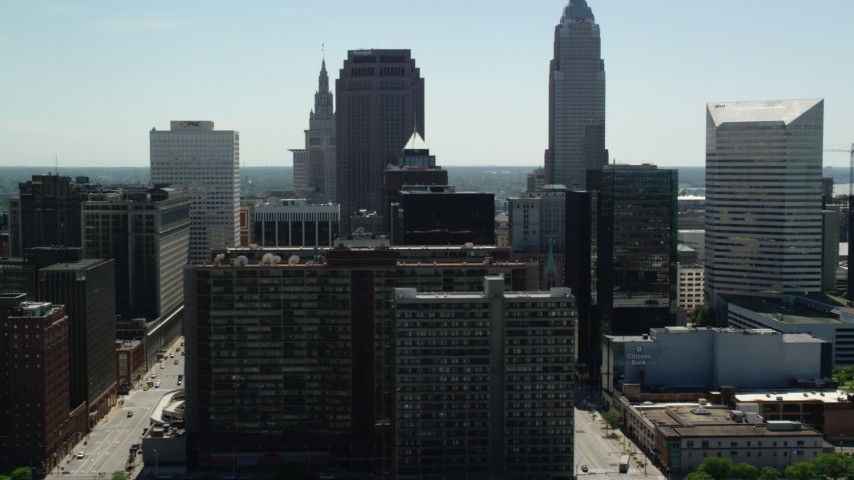 5K aerial video of skyscrapers and city streets in Downtown Cleveland, Ohio Aerial Stock Footage | AX106_226