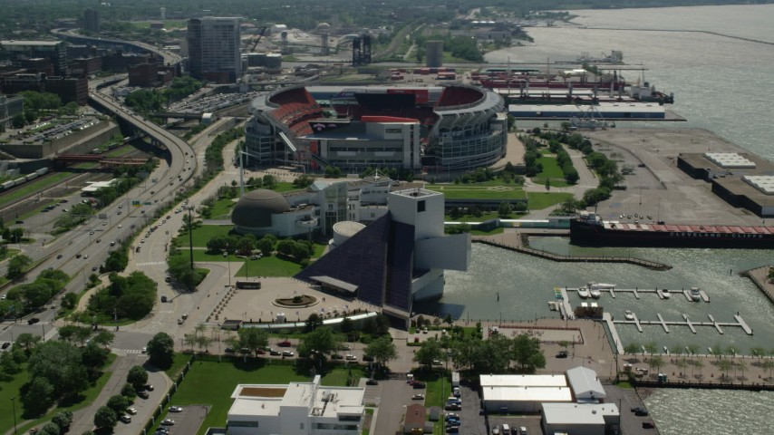 5K aerial video of Rock and Roll Hall of Fame and FirstEnergy Stadium in Downtown Cleveland, Ohio Aerial Stock Footage | AX106_228