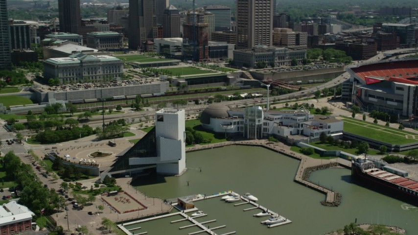 5K stock footage aerial video of Rock and Roll Hall of Fame and Great Lakes Science Center in Downtown Cleveland, Ohio Aerial Stock Footage | AX106_229