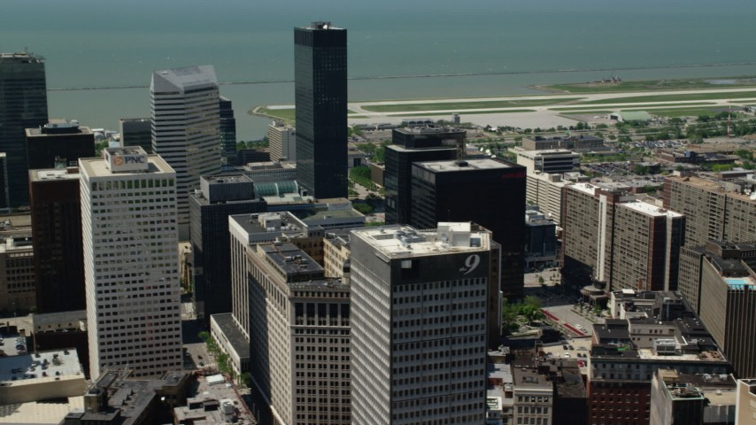 5K stock footage aerial video of office buildings and skyscrapers in Downtown Cleveland, Ohio Aerial Stock Footage | AX106_239