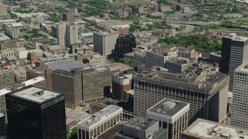 5K stock footage aerial video flying by office buildings in Downtown Cleveland, Ohio Aerial Stock Footage | AX106_252
