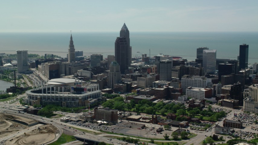 5K stock footage aerial video of Progressive Field and downtown skyscrapers in Downtown Cleveland, Ohio Aerial Stock Footage | AX106_257