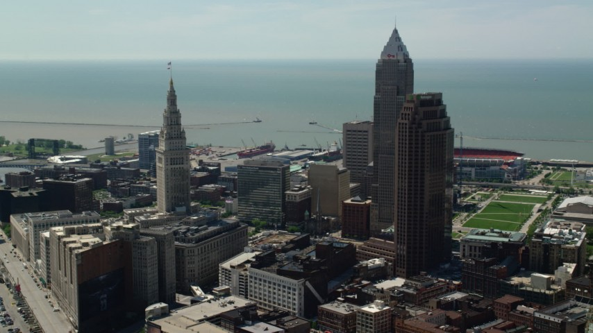 5K stock footage aerial video flying between Terminal Tower and 200 Public Square in Downtown Cleveland, Ohio Aerial Stock Footage | AX106_260