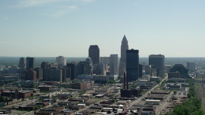 5K stock footage aerial video of Downtown Cleveland skyscrapers and industrial area, Ohio Aerial Stock Footage AX107_002 | Axiom Images