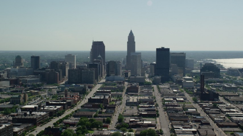 5K stock footage aerial video of Downtown Cleveland skyscrapers and industrial area, Ohio Aerial Stock Footage | AX107_003