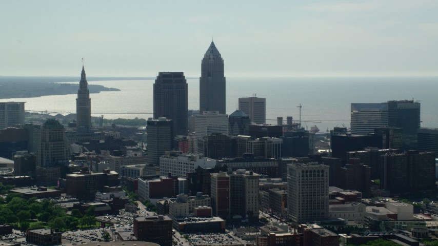 5K stock footage aerial video approaching Downtown Cleveland skyscrapers, Ohio Aerial Stock Footage | AX107_007