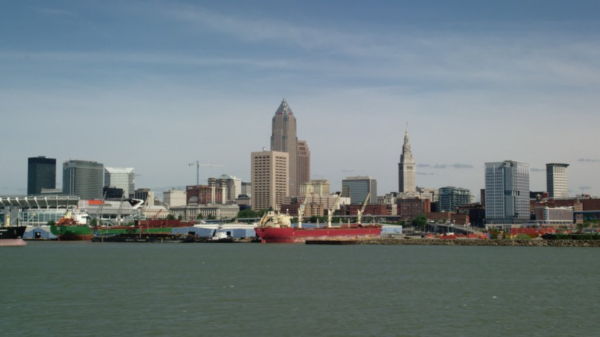 5K stock footage aerial video of Downtown Cleveland skyline seen from Lake Erie, Ohio Aerial Stock Footage | AX107_015