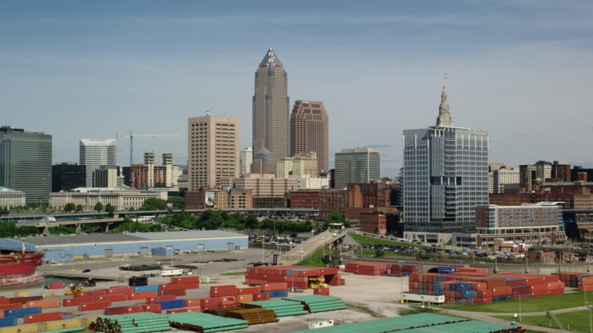 5K aerial video of Downtown Cleveland skyline from the shores of Lake Erie, Ohio Aerial Stock Footage | AX107_016