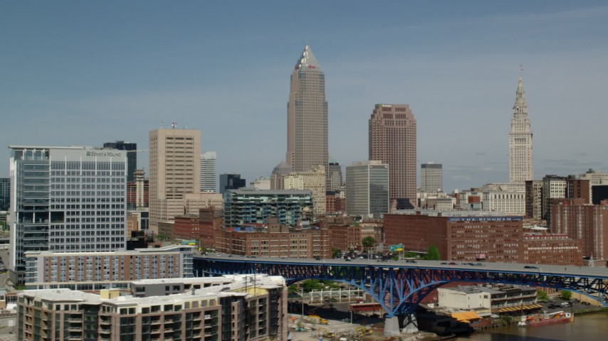 5K stock footage aerial video approaching Downtown Cleveland skyline, Ohio Aerial Stock Footage | AX107_018