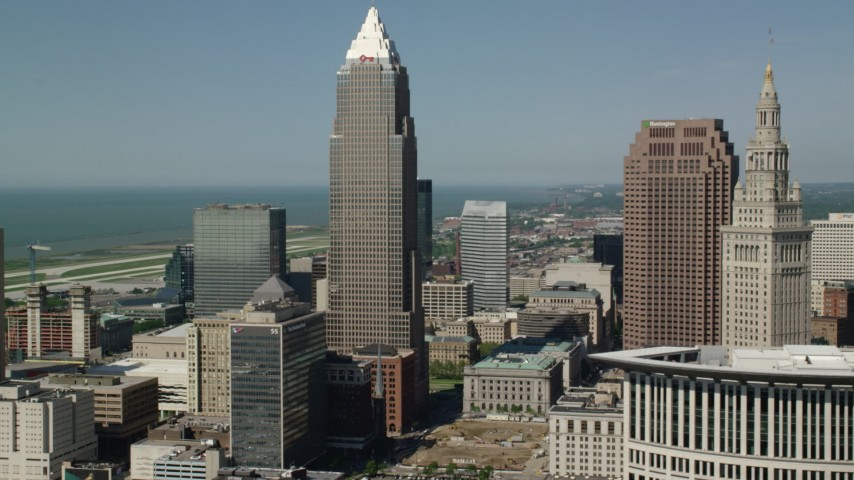 5K stock footage aerial video flying by Key Tower and Terminal Tower, Downtown Cleveland, Ohio Aerial Stock Footage | AX107_022