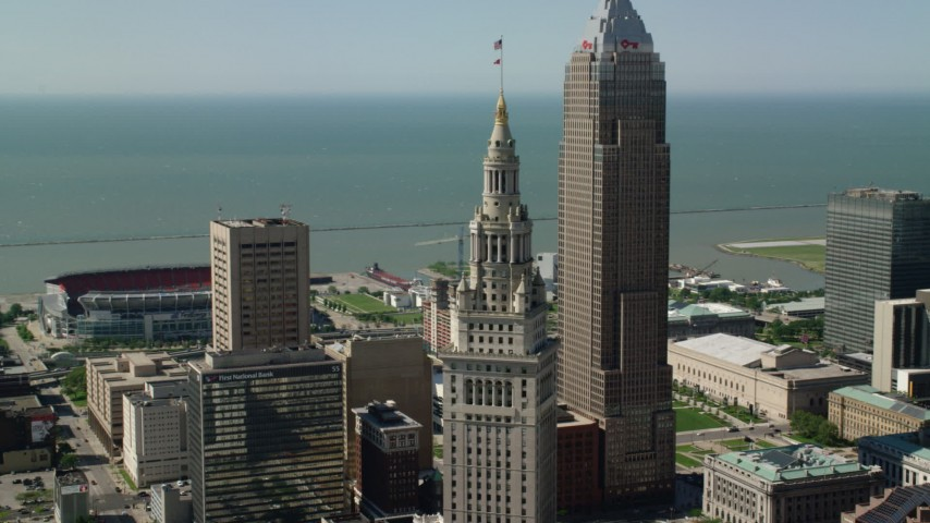 5K aerial video passing Key Tower and Terminal Tower, Downtown Cleveland, Ohio Aerial Stock Footage | AX107_024