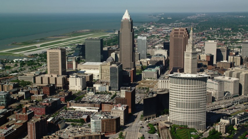5K stock footage aerial video of Key Tower and 200 Public Square among city buildings, Downtown Cleveland, Ohio Aerial Stock Footage | AX107_035