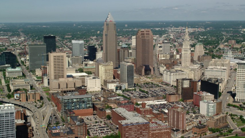 5K stock footage aerial video passing Downtown Cleveland skyscrapers and high-rises, Ohio Aerial Stock Footage | AX107_037
