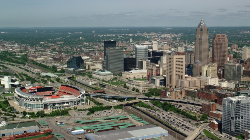 5K stock footage aerial video of Downtown Cleveland and FirstEnergy Stadium, formerly Cleveland Browns Stadium, Ohio Aerial Stock Footage | AX107_039