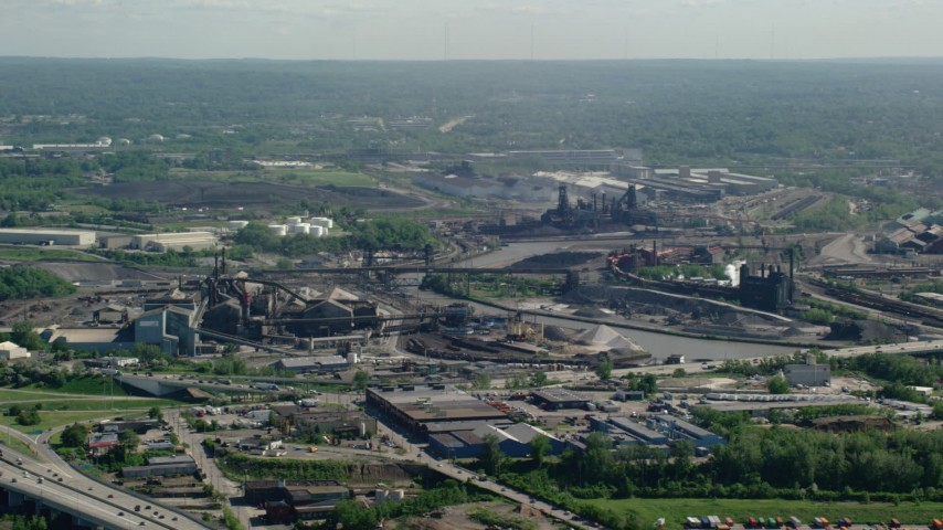 5K aerial video of factories along a river, Cleveland, Ohio Aerial Stock Footage | AX107_047