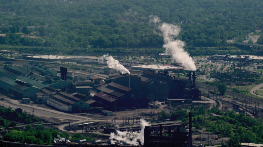 5K stock footage aerial video of a factory with smoke stacks, Cleveland, Ohio Aerial Stock Footage | AX107_048