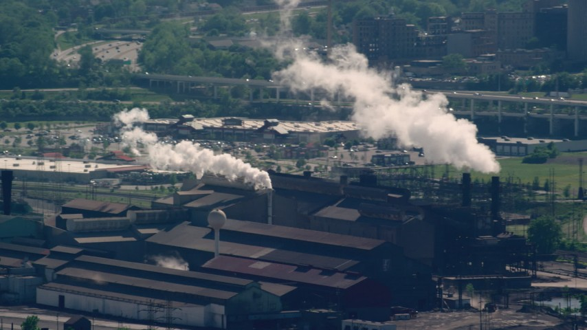 5K stock footage aerial video flying by factory with smoke stacks, Cleveland, Ohio Aerial Stock Footage | AX107_049